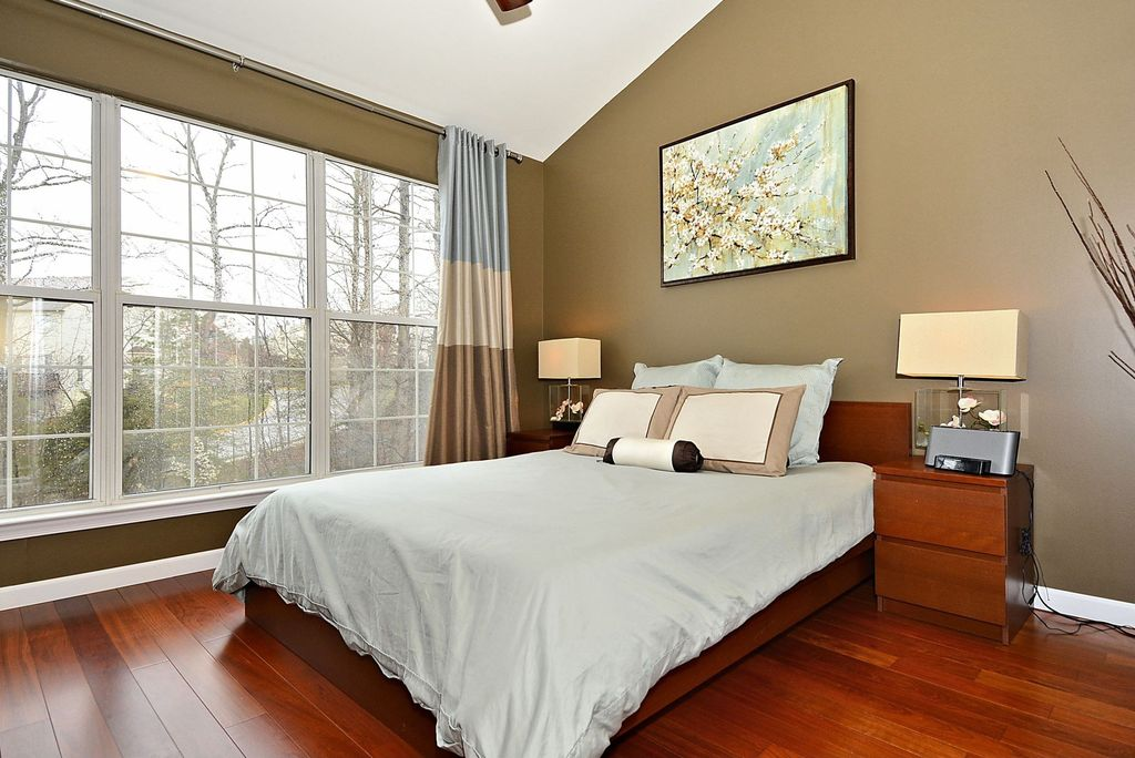 Traditional Master Bedroom with Ceiling fan, Standard height, double-hung window, Hardwood floors