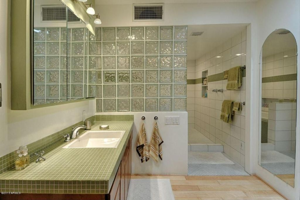 Traditional Master Bathroom with partial backsplash, Flush, large ceramic tile counters, drop-in sink, Standard height