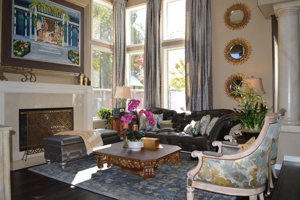 Eclectic Living Room with Columns, Fireplace, double-hung window, other fireplace, Laminate floors, High ceiling