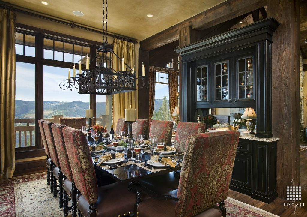 Traditional Dining Room with Hardwood floors, can lights, Chandelier, Standard height, picture window, Columns, Exposed beam