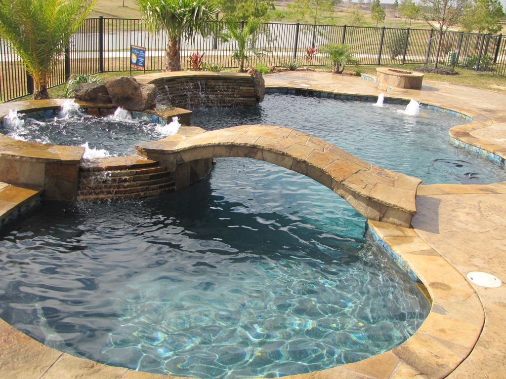 Rustic Swimming Pool with Poured concrete floors