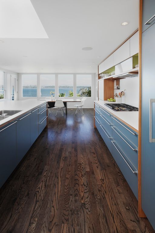 Contemporary Kitchen with Breakfast nook, Corian counters, Casa de Colour Walnut Hickory, Skylight, European Cabinets, Galley