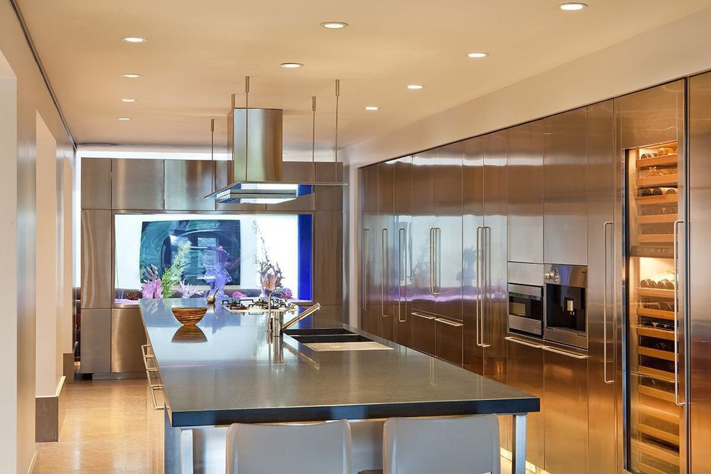 Contemporary Kitchen with European Cabinets, Slate counters, Standard height, L-shaped, Flush, Wine refrigerator, can lights