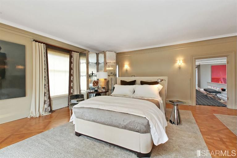 Contemporary Master Bedroom with Hardwood floors, Wall sconce, Standard height, Crown molding, picture window