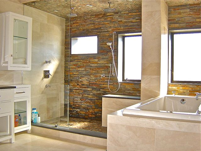 Contemporary Master Bathroom with Slate counters, picture window, can lights, Wall Tiles, Glass panel, European Cabinets