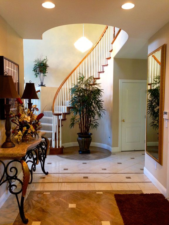 Traditional Hallway with stone tile floors, specialty door, simple marble tile floors, can lights, Standard height