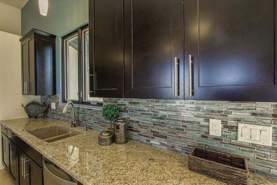 Contemporary Kitchen with dishwasher, Flat panel cabinets, Ms international - azurite granite, One-wall, Paint 2, Casement