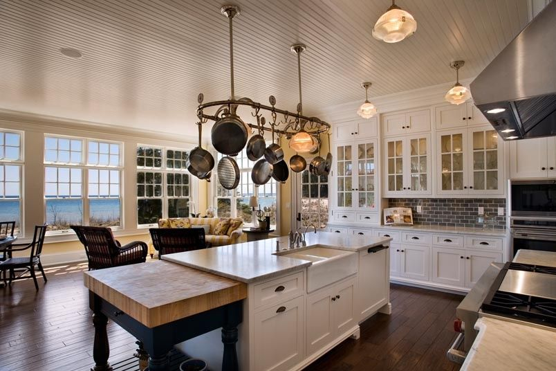 Cottage Kitchen with L-shaped, Flat panel cabinets, flush light, Limestone Tile, Powell prep table butcher block, Glass panel