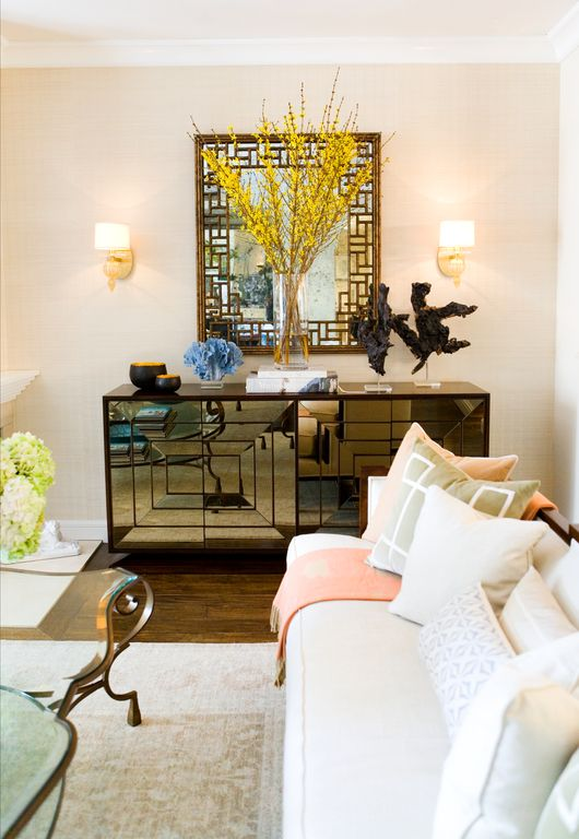 Eclectic Living Room with Hardwood floors, Crown molding, Wall sconce, Standard height