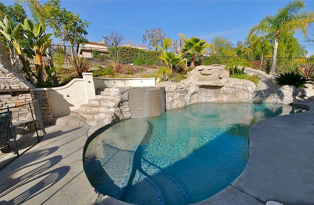 Tropical Swimming Pool with exterior stone floors, Fence, Other Pool Type