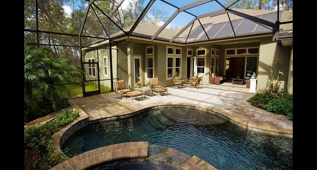 Traditional Patio with Skylight, Raised beds, Transom window, sliding glass door, exterior stone floors, Pathway