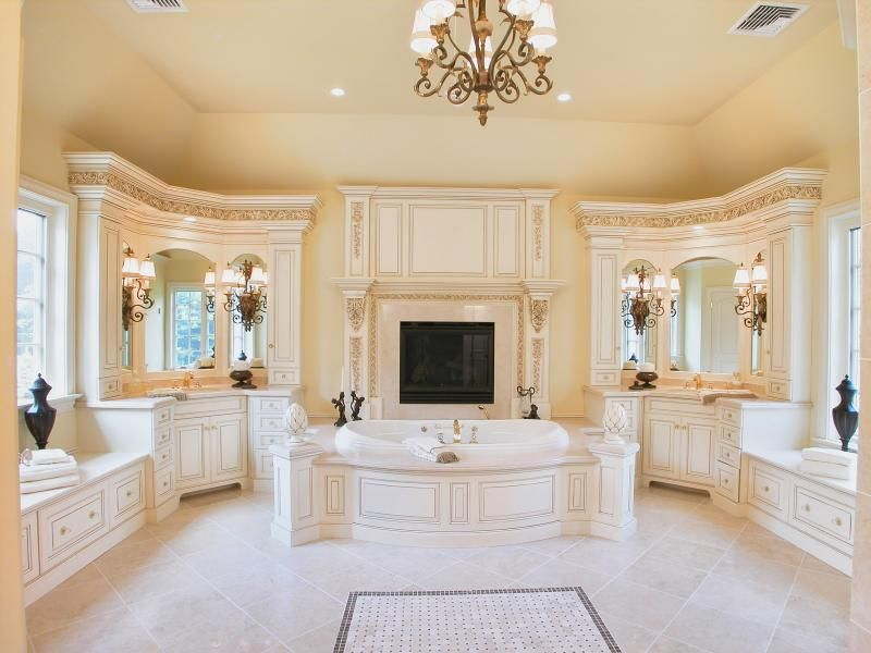 Traditional Master Bathroom with Bathtub, Raised panel, Fireplace, specialty door, Flush, partial backsplash, Chandelier