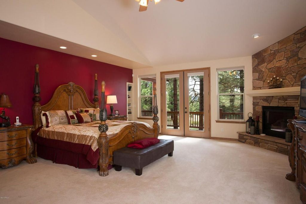 Rustic Master Bedroom with stone fireplace, Fireplace, Standard height, Ceiling fan, metal fireplace, can lights, Carpet