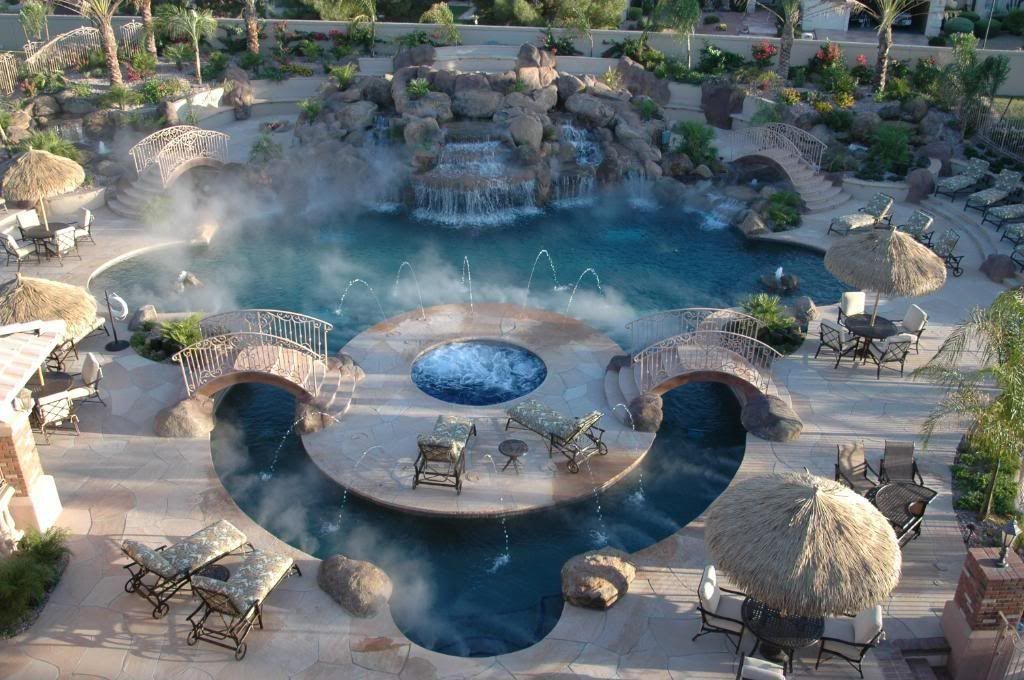 Tropical Swimming Pool with Pool with hot tub, Fence, Raised beds, Pond, Pathway, Fountain, Other Pool Type, Deck Railing