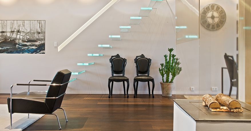 Modern Staircase with Hardwood floors, High ceiling, Glass staircase