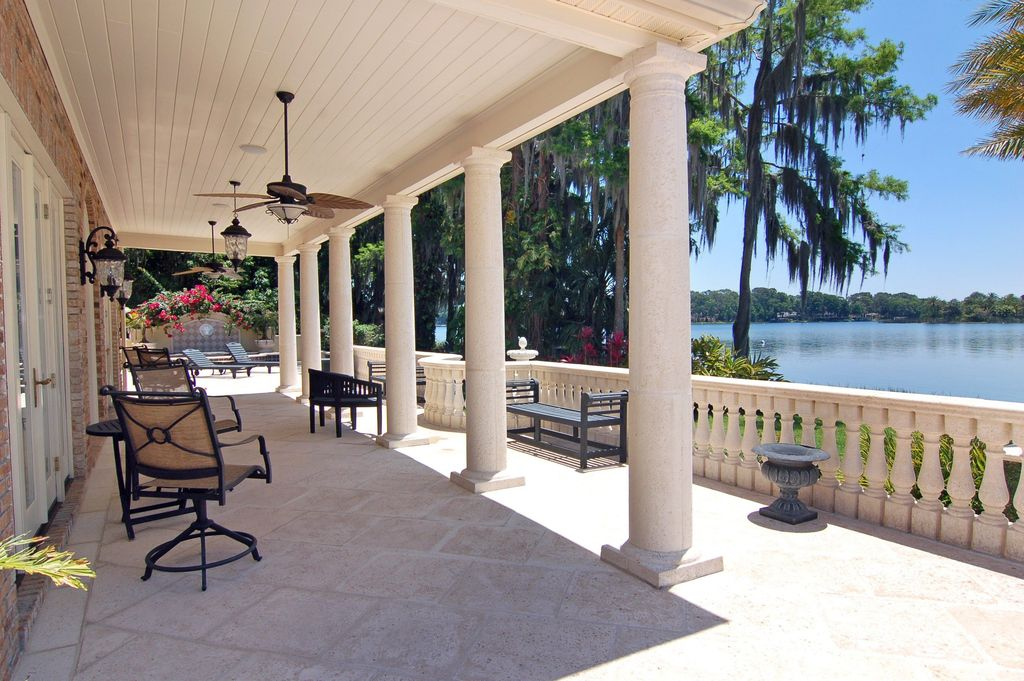 Traditional Porch with exterior tile floors, Newport outdoor swivel chair, Wrap around porch, exterior concrete tile floors