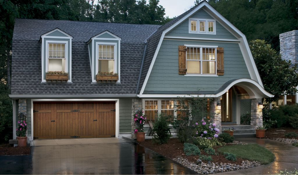 Country Exterior Of Home With Wood Shutters By Hollywood Crawford Door Compan