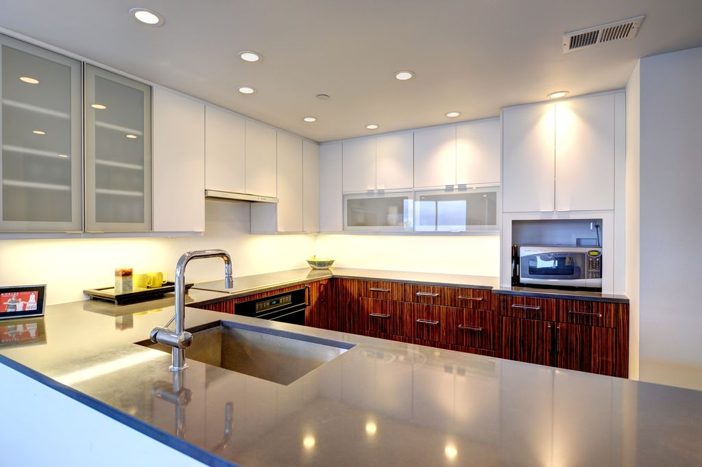 Modern Kitchen with European Cabinets, U-shaped, Flush, Undermount sink, Glass panel, Custom hood, Stainless steel counters