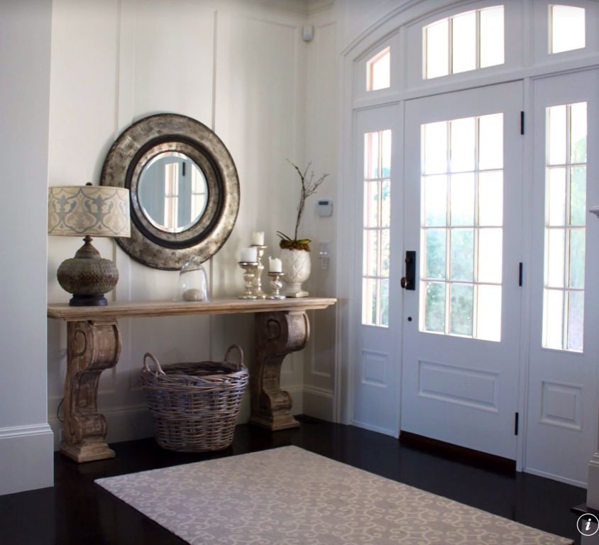 Traditional Entryway with Wide base boards, Paint, Wood panel wall, Transom window, French doors, Concrete floors