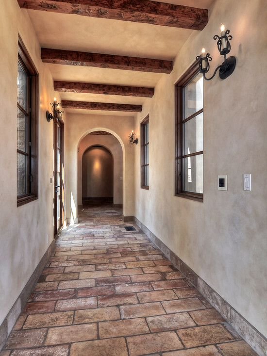 Mediterranean Hallway with Casement, French doors, Exposed beam, travertine floors, Standard height, Wall sconce