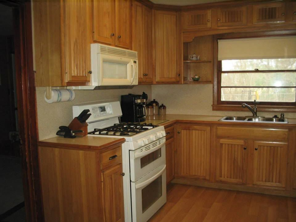 Rustic Kitchen with built-in microwave, Multiple Sinks, Standard height, double-hung window, Inset cabinets, Formica counters