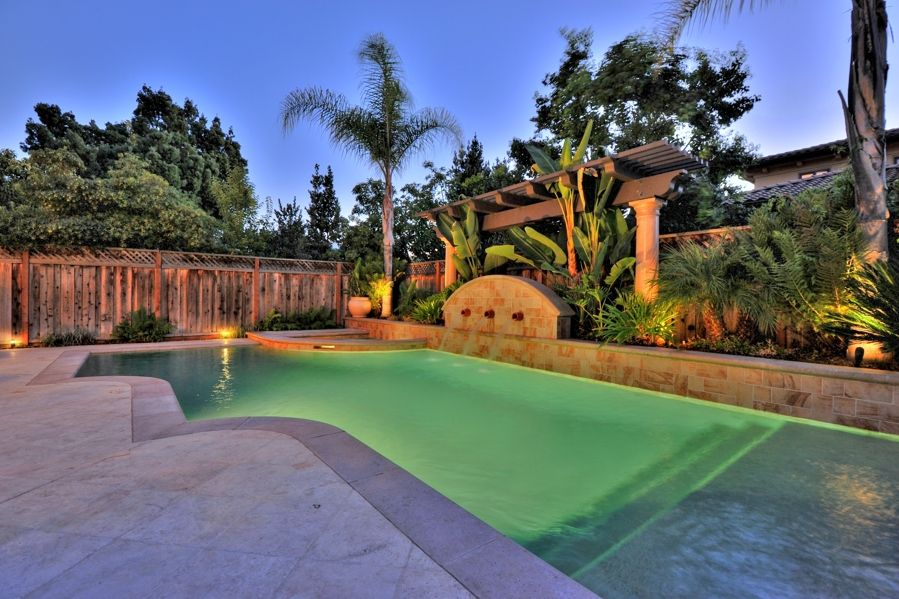Tropical Swimming Pool with Pool with hot tub, Raised beds, Fountain, Trellis, exterior concrete tile floors, Fence