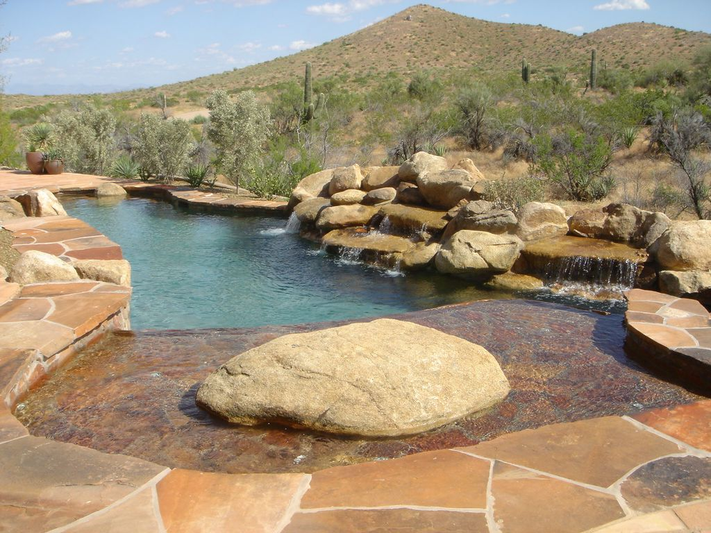 Rustic Swimming Pool with exterior stone floors, Fountain, Other Pool Type
