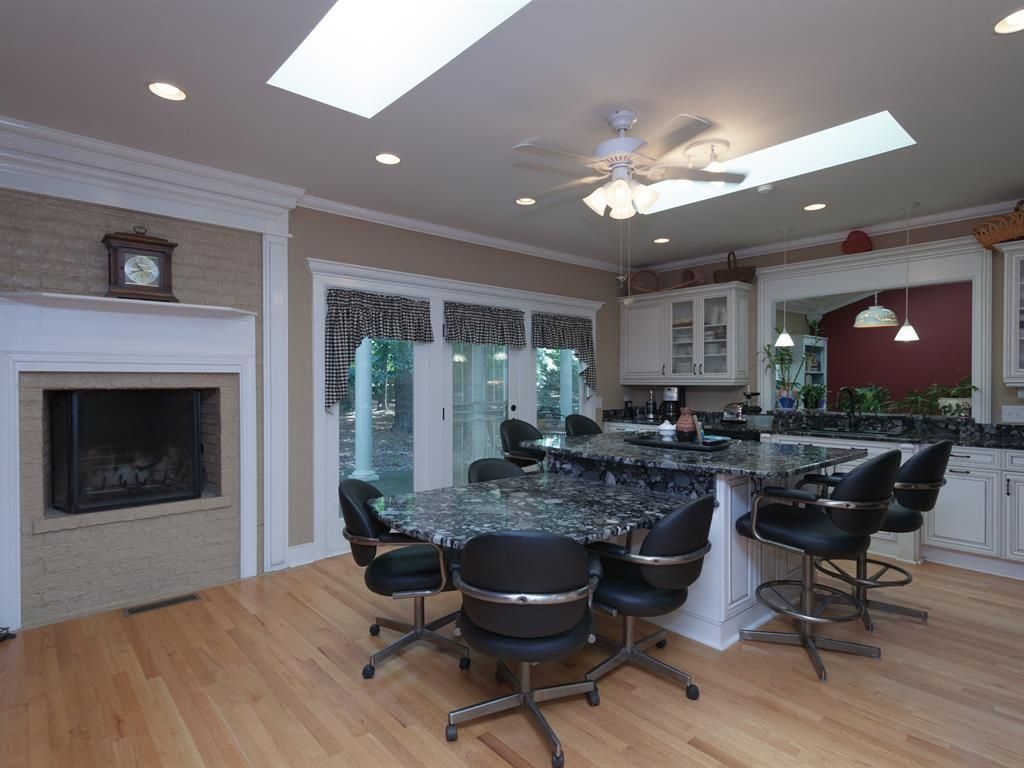 Traditional Kitchen with Kitchen island, Breakfast bar, Skylight, Crown molding, Pendant light, Flush, can lights, Fireplace