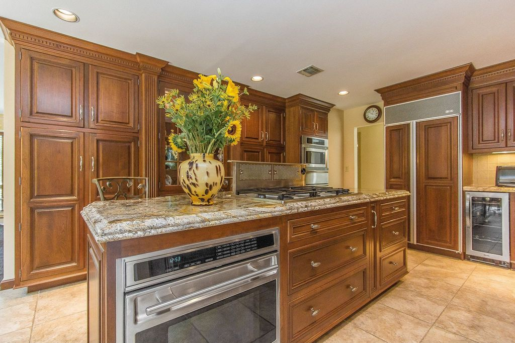 Craftsman Kitchen with Inset cabinets, Built-in microwave drawer, Standard height, Wine refrigerator, stone tile floors