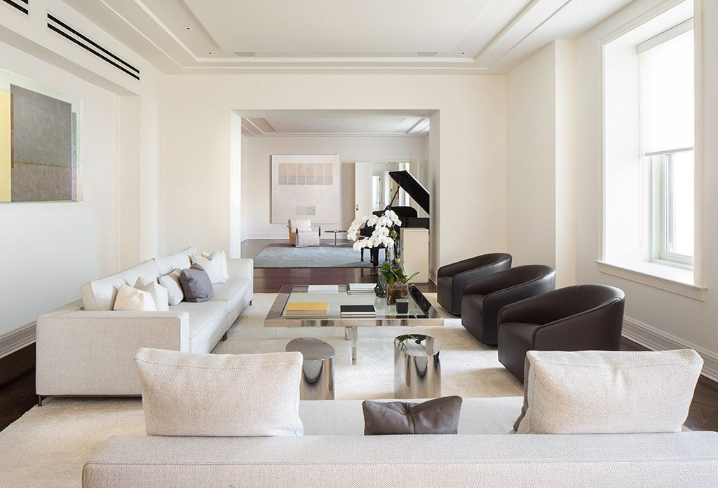 Contemporary living room with hardwood floors by the for W living room new york