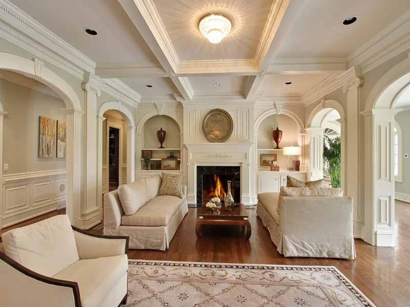 Traditional Living Room with can lights, Cement fireplace, Wainscotting, Hardwood floors, Box ceiling, Built-in bookshelf