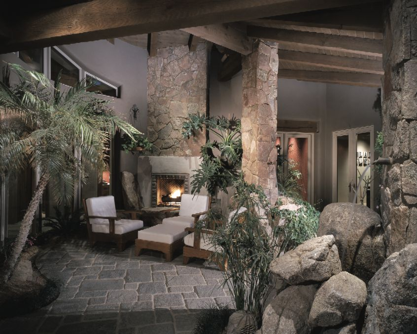 Eclectic Porch with sliding glass door, Transom window, Wrap around porch, exterior stone floors