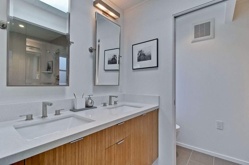 Modern Master Bathroom with Pottery Barn Kensington Rectangular Mirror, Delta Arzo Two Handle Widespread Lavatory Faucet