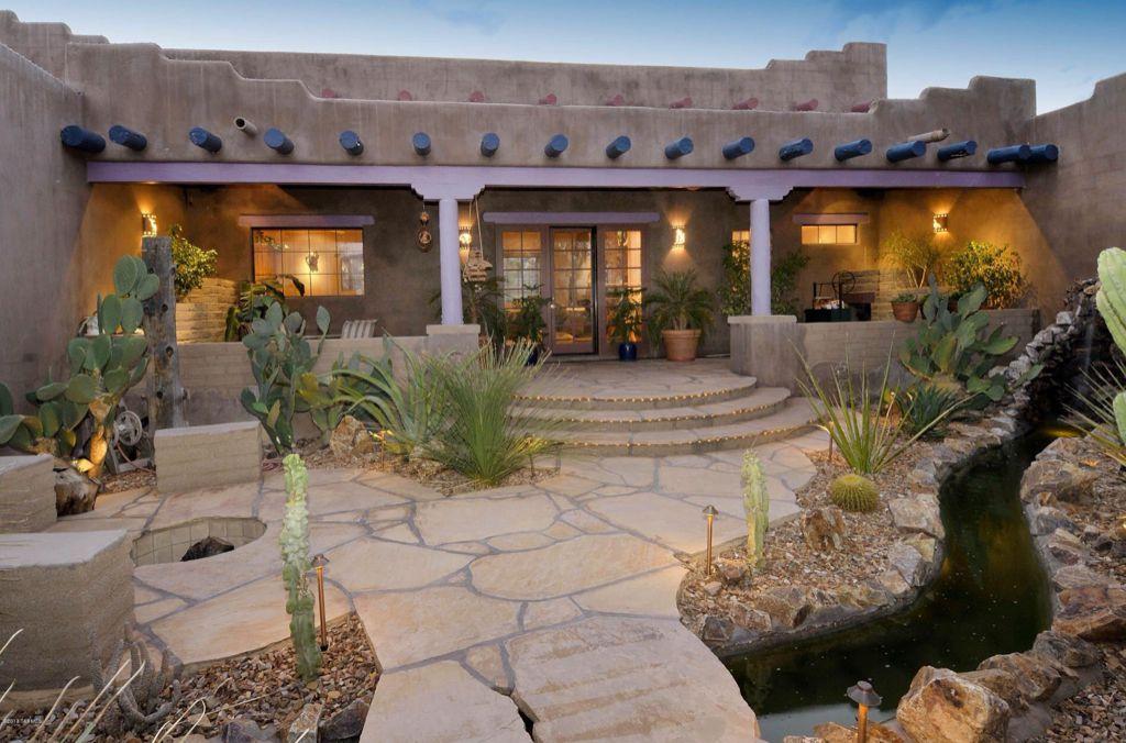 Eclectic Landscape/Yard with Casement, Deck Railing, Trellis, exterior stone floors, sliding glass door, Fire pit
