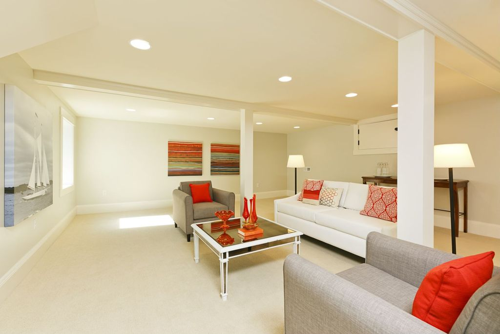 Contemporary Living Room with Exposed beam, Carpet, Built-in bookshelf, Casement, can lights, Standard height, Columns