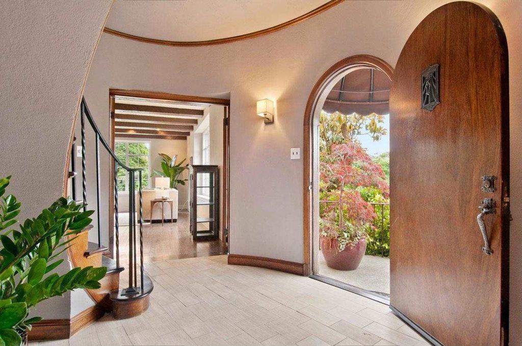 Mediterranean Entryway with stone tile floors, Crown molding, Standard height, limestone tile floors, specialty door
