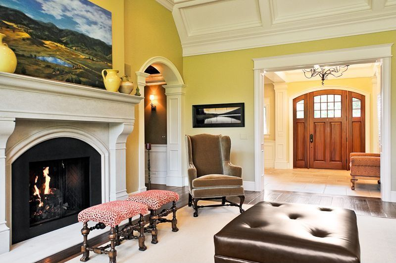 Traditional Living Room with Crown molding, Cement fireplace, Fireplace, Box ceiling, Standard height, Hardwood floors