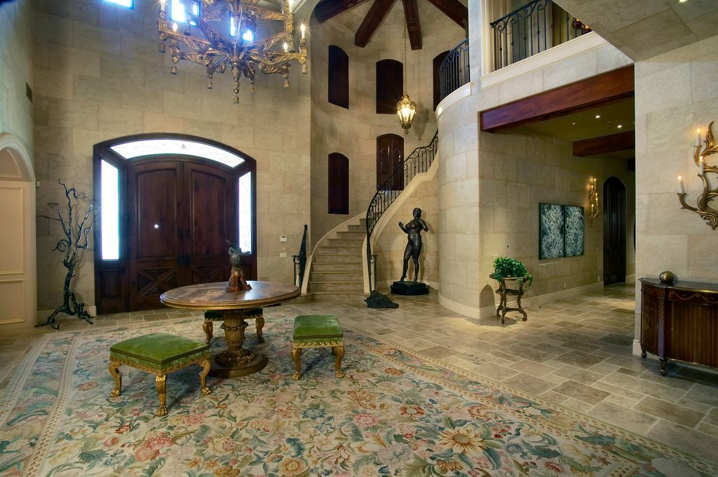 Mediterranean Entryway with High ceiling, picture window, French doors, Exposed beam, Chandelier, Concrete tile