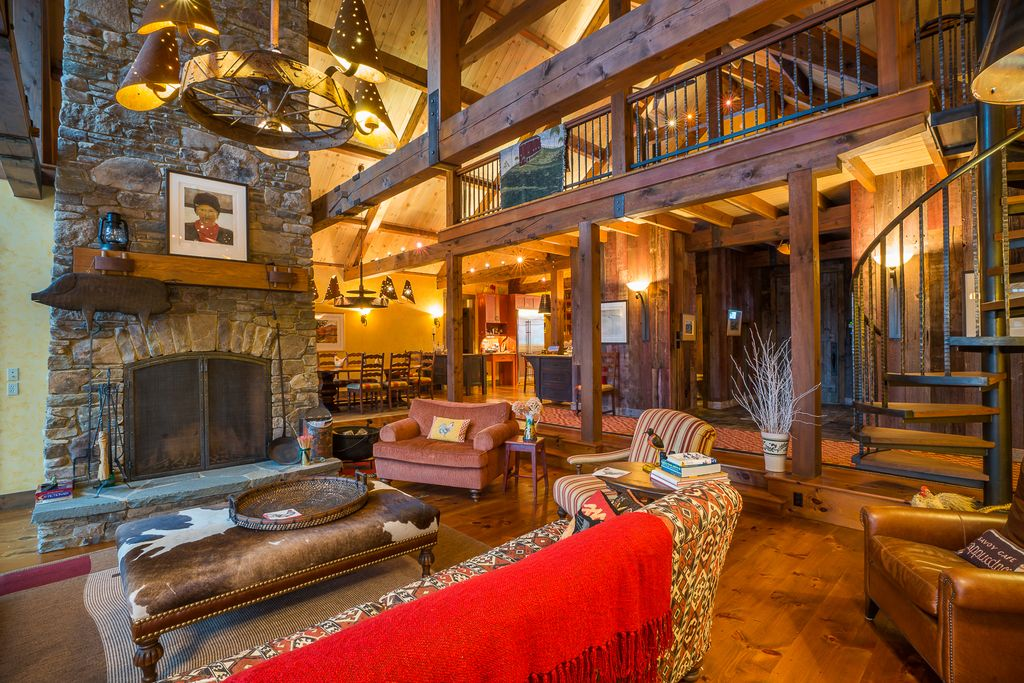Rustic Great Room with picture window, Exposed beam, Sunken living room, Loft, Built-in bookshelf, stone fireplace, Fireplace