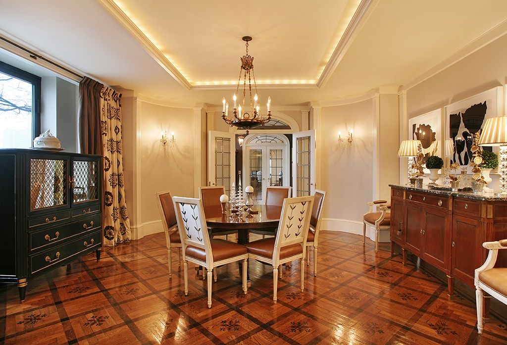 Traditional Dining Room with Chandelier, Crown molding, Transom window, picture window, Wall sconce, Laminate floors