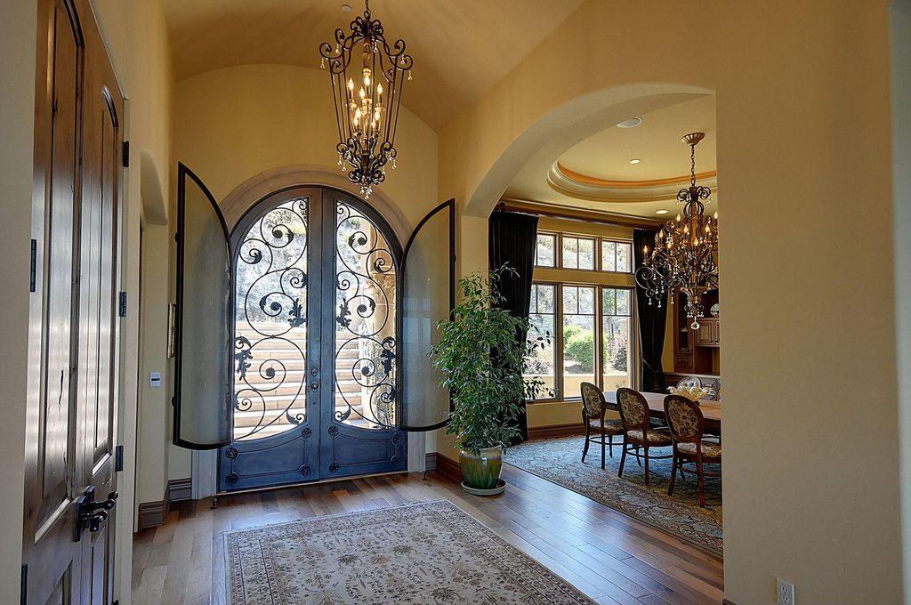 Mediterranean Entryway with Chandelier, High ceiling, Golden lighting 12 light jefferson chandelier, Hardwood floors, Paint 1