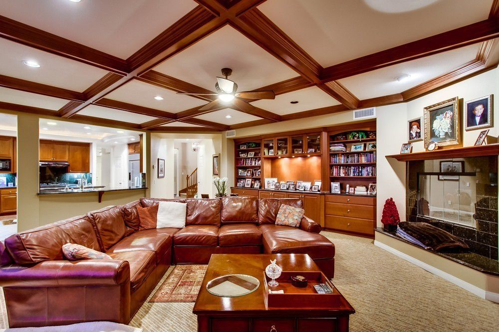 Traditional Living Room with Galaxy black granite tile, Box ceiling, can lights, Built-in bookshelf, stone fireplace, Carpet