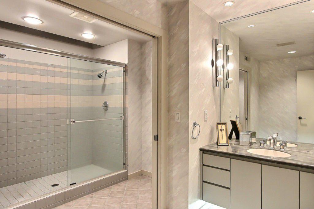Contemporary 3/4 Bathroom with three quarter bath, Travertine counters, limestone tile floors, flush light, flat door, Shower