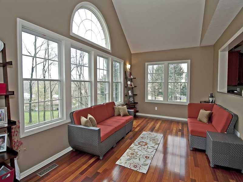 Traditional Living Room with High ceiling, Hardwood floors, Built-in bookshelf, Wall sconce, double-hung window