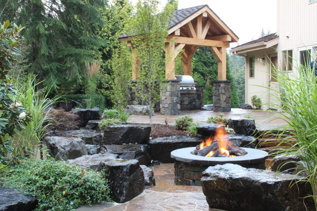 Rustic Patio with exterior stone floors, Fire pit, Outdoor kitchen, Pathway, Gazebo