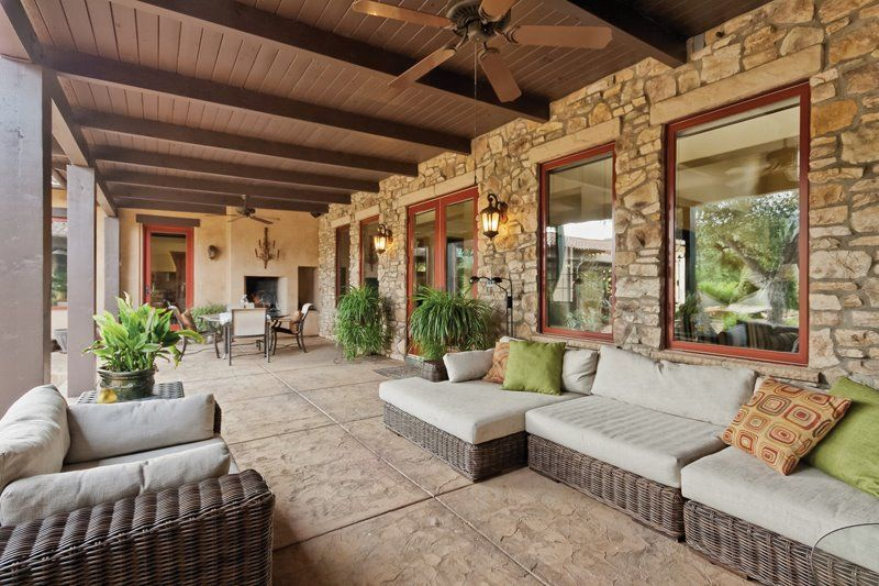 Modern Porch with Screened porch, exterior stone floors, picture window, French doors