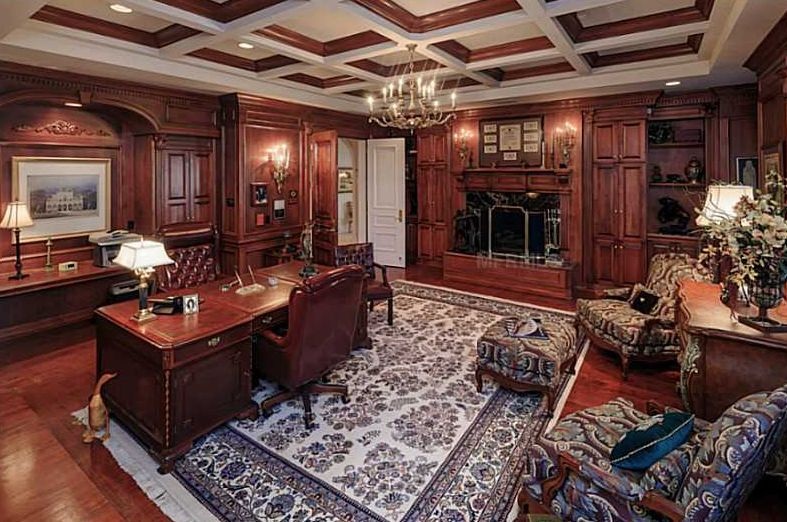 Traditional Home Office with Fireplace, can lights, Wall sconce, Crown molding, Box ceiling, Built-in bookshelf, Chandelier