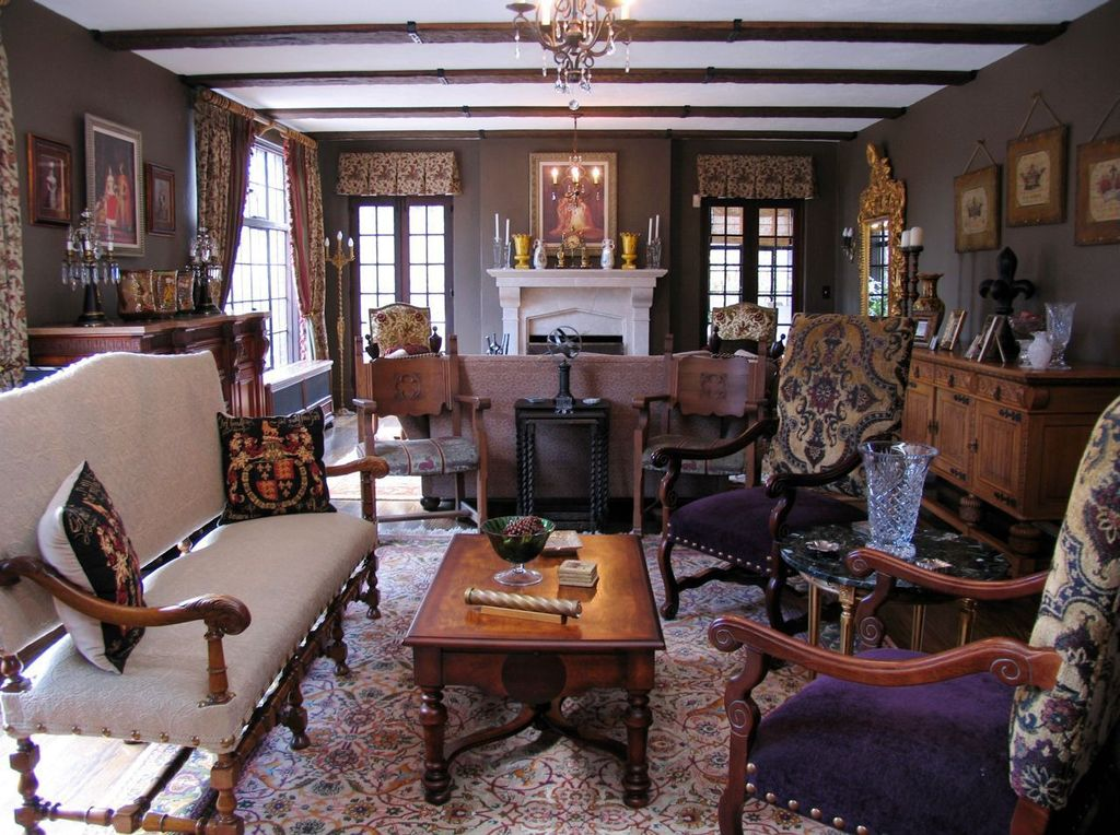 Traditional Living Room with Chandelier, Casement, Hardwood floors, French doors, Standard height, Fireplace, Exposed beam